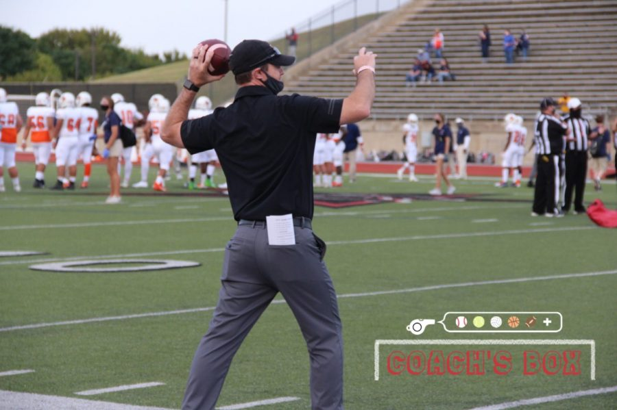 Coppell assistant Blaine Barnett passes during pregame warmups before the Cowboys' 42-35 victory against Sachse on Oct. 2 at Buddy Echols Field. In addition to coaching football, Barnett teaches special education at Coppell High School.