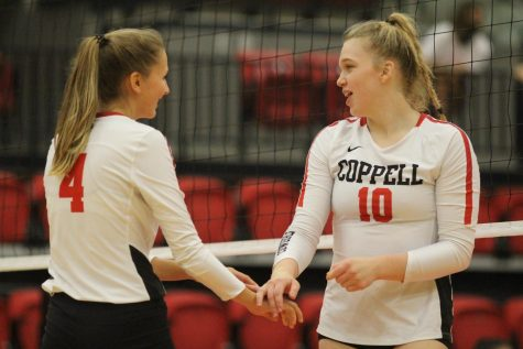 Coppell junior right side hitter Abigail Hendricks and sophomore outside hitter Reagan Engler celebrate against Prosper Rock Hill in the CHS Arena on Friday. Coppell plays Hebron tomorrow at 6:30 p.m. in the CHS Arena.
