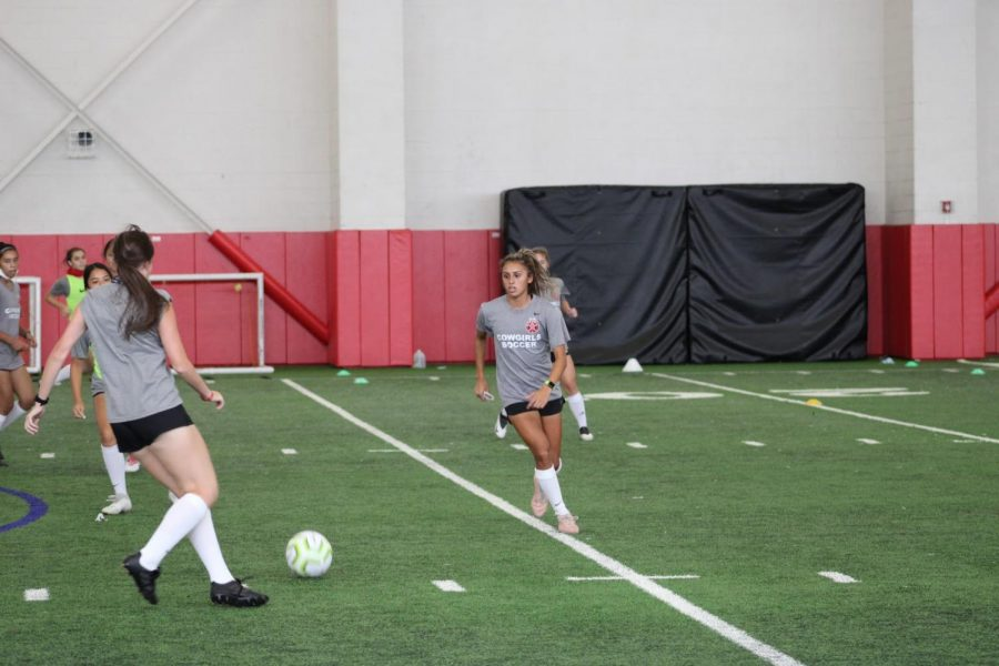 Coppell senior midfielder Jojo Alonzo participates in soccer practice on Tuesday in the CHS Field House. Despite COVID-19, athletes are continuing to play sports with adjusted fitness habits.