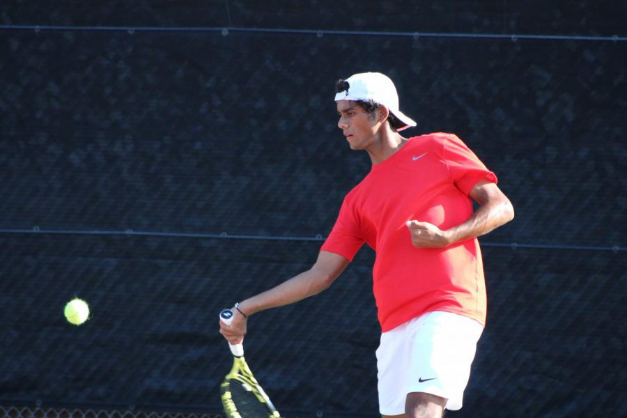 Coppell senior Kunal Seetha hits a forehand against Plano West on Sept. 25 at the CHS Tennis Center. Coppell will be playing Prosper in Class 6A Region I bi-district playoffs today.