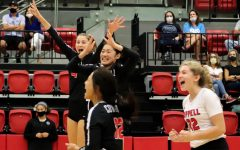 Coppell junior right side Abby Hendericks, senior setter Mari Taira, junior defensive specialist Meagan Lee and junior libero Rebeca Centeno celebrate after scoring against Hebron at the CHS Arena on Friday. Coppell swept Hebron, 25-21, 25-20, 25-16, to bring its District 6-6A record to 2-2.