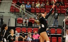Coppell senior middle hitter Madison Gilliland spikes against Hebron on Oct. 9 at the CHS Arena. Coppell returns to district play after a two-week quarantine to face Marcus at 6:30 p.m. tomorrow night at the CHS Arena.