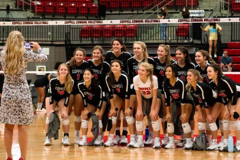 Coppell coach Julie Price takes a picture of the Coppell volleyball team after their win against Hebron on Oct. 9. The Cowgirls are under quarantine until Oct. 23 after identifying a positive COVID-19 test result.