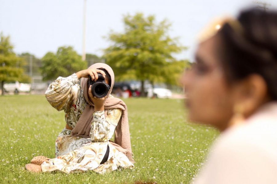Coppell High School senior Yusra Mohammed photographs CHS senior Nausheen Ahmed at Moore Road Park on Sept. 19. Mohammed's photography is centered around cultural fashion in order to highlight the beauty of individuality.
