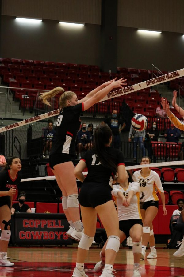 Coppell sophomore middle blocker Reagan Engler blocks against Plano East on Oct. 6. The Cowgirls defeated the Panthers, 3-1.