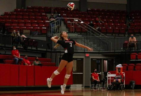 Coppell sophomore Karissa Cameron serves the ball during the game against Plano East on Tuesday. The Cowgirls defeated the Panthers 3-1.