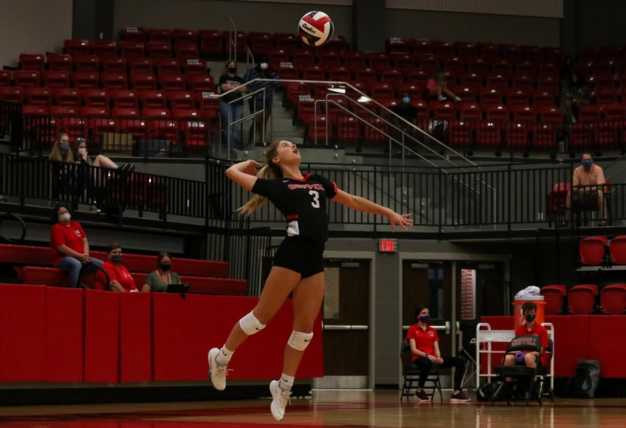 Coppell+sophomore+Karissa+Cameron+serves+the+ball+during+the+game+against+Plano+East+on+Tuesday.+The+Cowgirls+defeated+the+Panthers+3-1.+