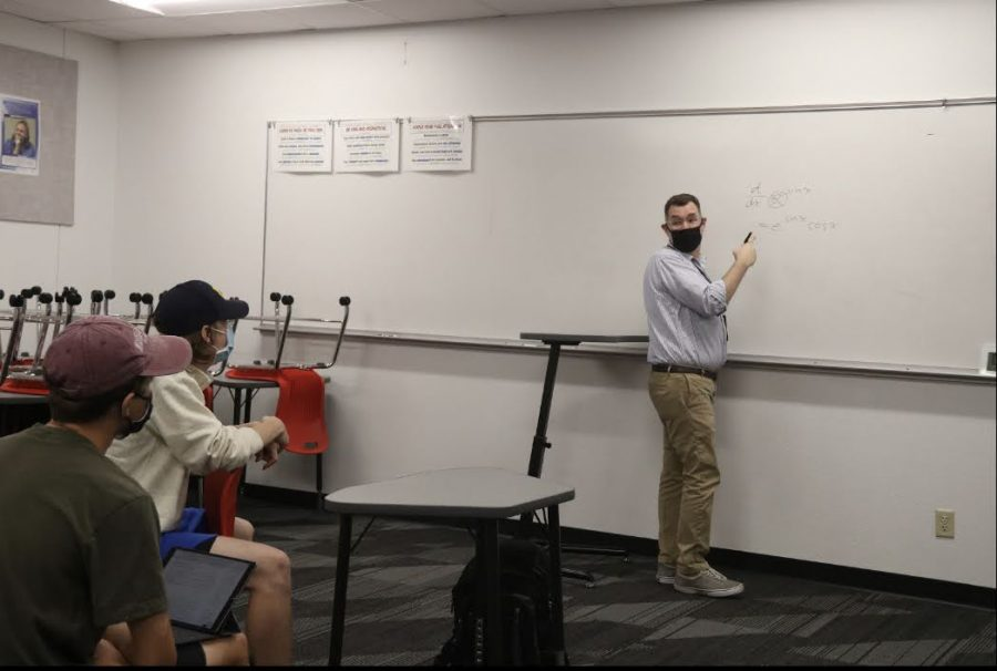 Coppell High School IB math and AP calculus BC teacher Ian VanderSchee teaches CHS seniors Austin Gregory and Nathan Crawford during second period on Monday in B121. VanderSchee was nominated for the Outstanding Educator Award by CHS 2019 graduate Dwija Dammanna.
