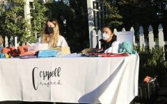 New Tech High @ Coppell sophomore Payton Hoenig and Coppell High School sophomore Reagann Stolar sell handmade products for their business, Coppell Crafted, on Saturday at Old Town Coppell. Stolar and Hoenig started Coppell Crafted as a hobby and developed it  to help the city by donating a portion of profits to various charities and movements. Photo by Nandini Muresh