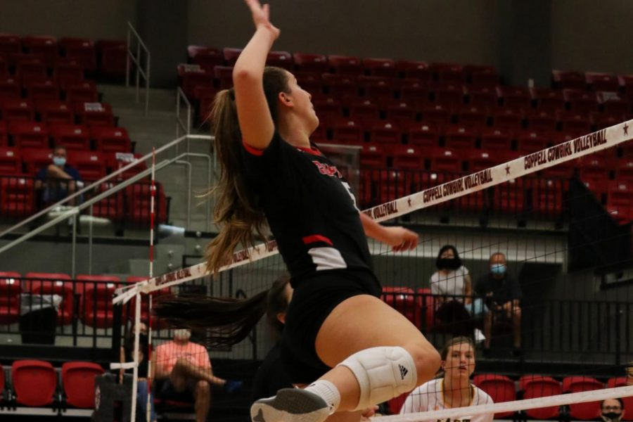 Coppell senior middle hitter Madison Gilliland spikes against the Panthers at the CHS Arena on Tuesday. Madison has been in Coppell's varsity team for four years and will graduate early this December.