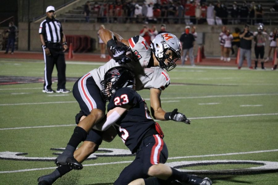 Coppell sophomore defensive back Matthew Williams tackles Marcus junior wide receiver Dallas Dudley on Friday at Buddy Echols Field. The Cowboys lost to the Marauders, 38-24.