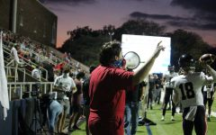 Coppell High School senior Plunger Boy Ryan Tompkins cheers from the sidelines during Coppell's game against Highland Park on Oct. 9 at Highlander Stadium. In the midst of a pandemic, Tompkins leads the student section and cheers Coppell in their victory.