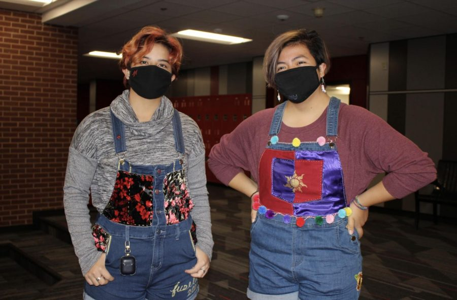 Coppell High School seniors Catherine Fuselier and Soleil Ramirez wear senior overalls to school for spirit day on Oct. 30. Last week, each day had a theme for Red Ribbon and Homecoming week.