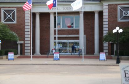 The entrance of the Coppell Town Center building is ready for voters on Oct. 19 for early voting during the 2020 election. Coppell has taken numerous sanitation procedures so citizens may vote in the safest way possible.