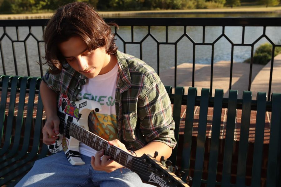 Coppell High School senior Cameron Reid plays guitar at Andy Brown Park East on Oct. 21. Coppell has a rich history in the arts whether it be performing or visual.