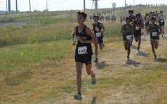Coppell junior Lane Jacobs stays ahead of a pack at the Coppell Invitational on Sept. 4, 2019 at the course at Coppell Middle School West.