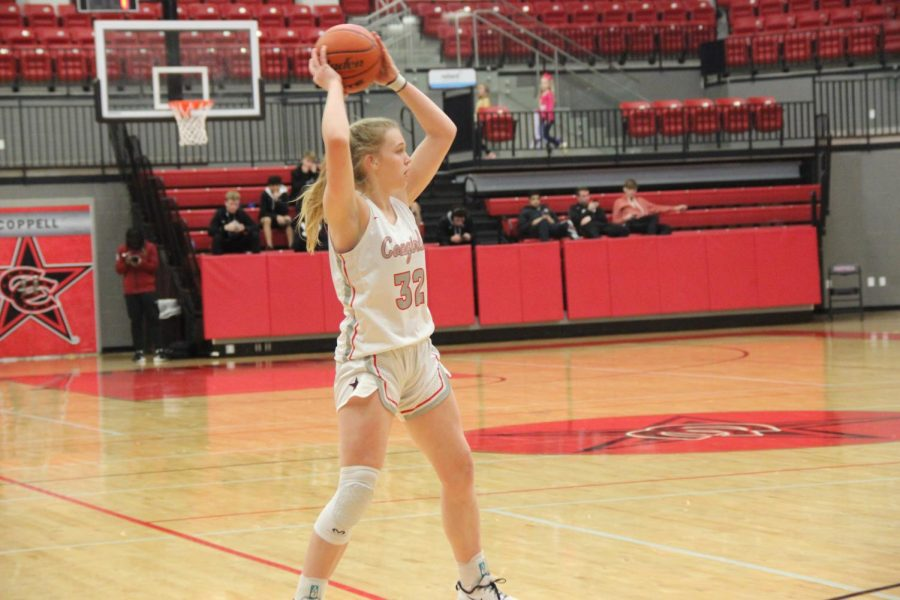 Coppell sophomore forward Reagan Engler looks to pass in the CHS Arena on Jan. 21 against MacArthur. Coppell plays Richland tomorrow night at 6:30 p.m. at the CHS Arena.