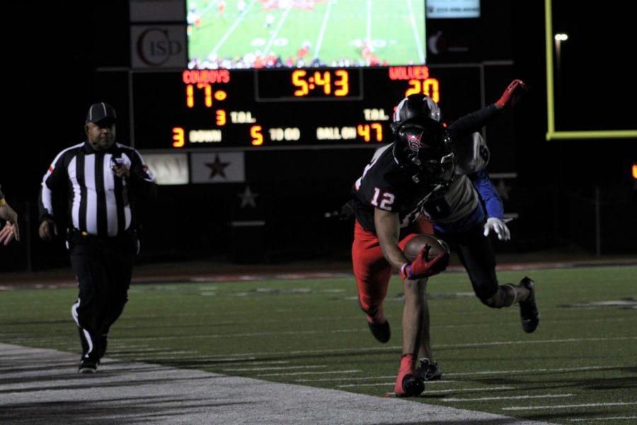 Coppell junior wide receiver Dylan Nelson is pushed out of bounds in the fourth quarter by Plano West senior defensive back Matthew Thompson on Oct. 30 at Buddy Echols Field. Coppell defeated Plano West, 31-20, in its annual homecoming game.