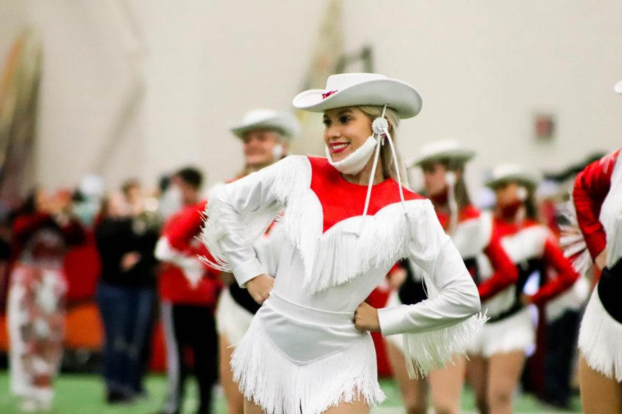 Coppell High School Lariette senior lieutenant Mia Freedman performs the Lariettes' traditional Wild Wild West dance in the 2020 virtual homecoming pep rally in the Coppell indoor facility on Oct. 27. The annual homecoming pep rally was moved online due to COVID-19.