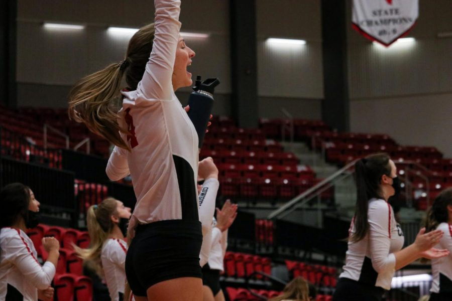 Coppell right side hitter Abigail Hendricks and her teammates cheer on the Cowgirls during the game in the CHS Arena on Saturday. Plano West defeated Coppell 2-3.