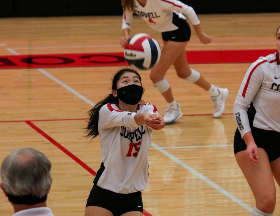 Coppell senior setter Mari Taira hits against Plano West in the CHS Arena on Saturday. Coppell travels to Frisco Heritage to play its Class 6A Region I bi-district playoff against nationally ranked Prosper.