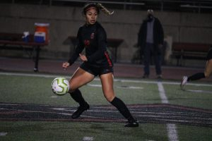 Coppell junior midfielder Renata Vargas looks for an open teammate against Mansfield at Buddy Echols Field on Tuesday. Vargas verbally committed  to The University of Texas Rio Grande Valley on Sept. 7.