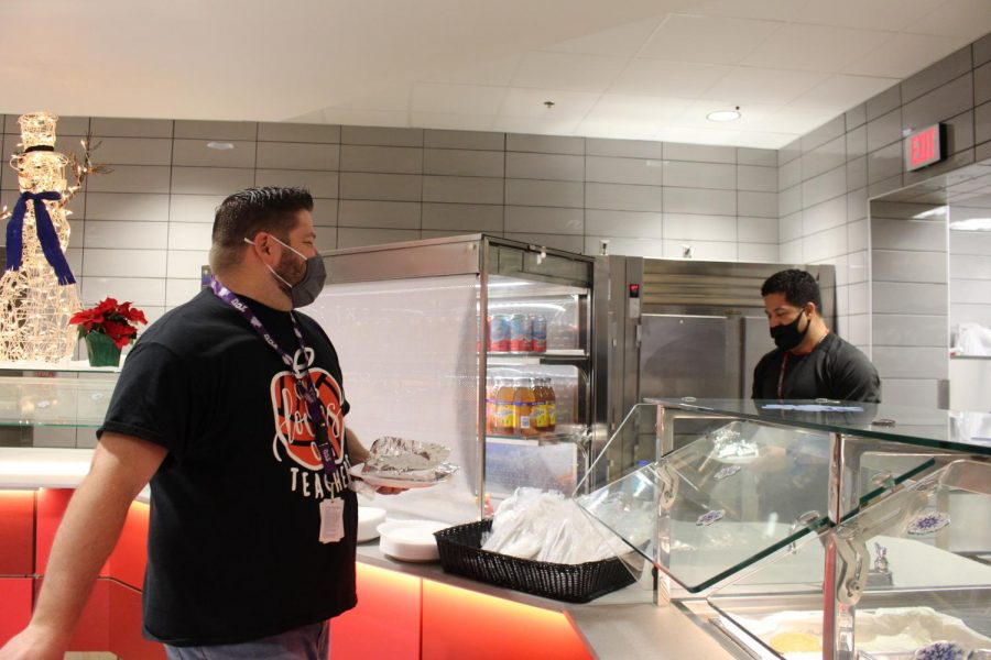 CHS9 Principal Cody Koontz chats with Coppell High School assistant principal Nick Coenraad in the CHS9 cafeteria on Wednesday. Koontz has led many projects for CHS9 over the past semester and discusses goals he has for the rest of the school year.