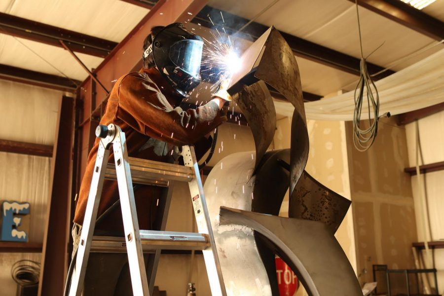 Local sculptor Russ Connell welds a piece in his studio in Denton on Tuesday. Connell has two sculptures in Coppell, one in Old Town and the other at Andy Brown Park East