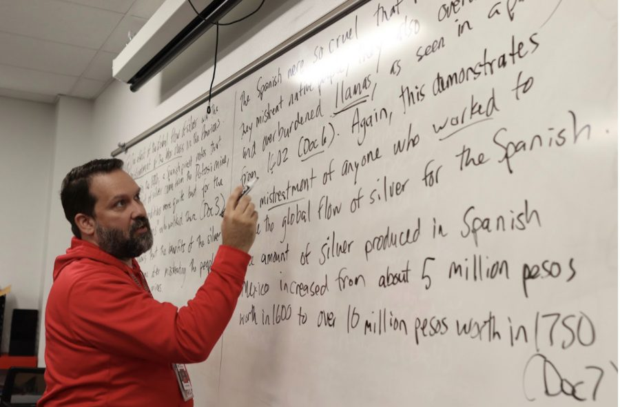 Coppell High School AP world history teacher Shawn Hudson goes over document-based question writing with his class on Zoom on Friday. Hudson was selected as The Sidekick Teacher the Issue for December. Photo by Lilly Gorman