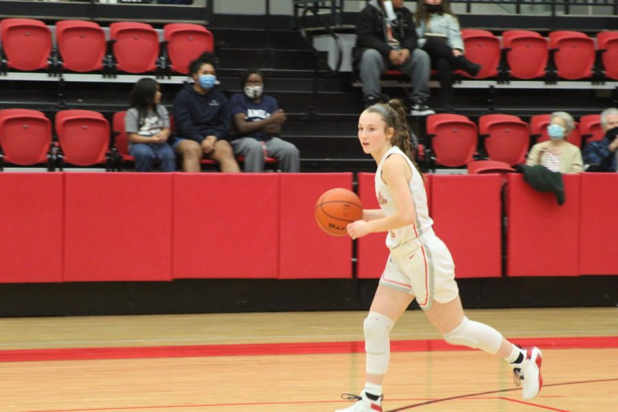 Coppell sophomore guard Allyssa Potter dribbles down court at the CHS Arena against Richland  on Dec. 1. Potter spent her free time during last spring's stay-at-home orders refining her basketball skills to become a better player.