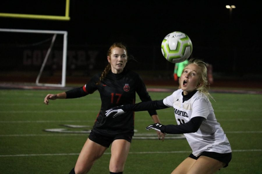 Coppell senior defender Addison Martin defends against Mansfield at Buddy Echols Field on Tuesday. Coppell and Mansfield tied, 1-1, in the Cowgirls' first scrimmage of the season.