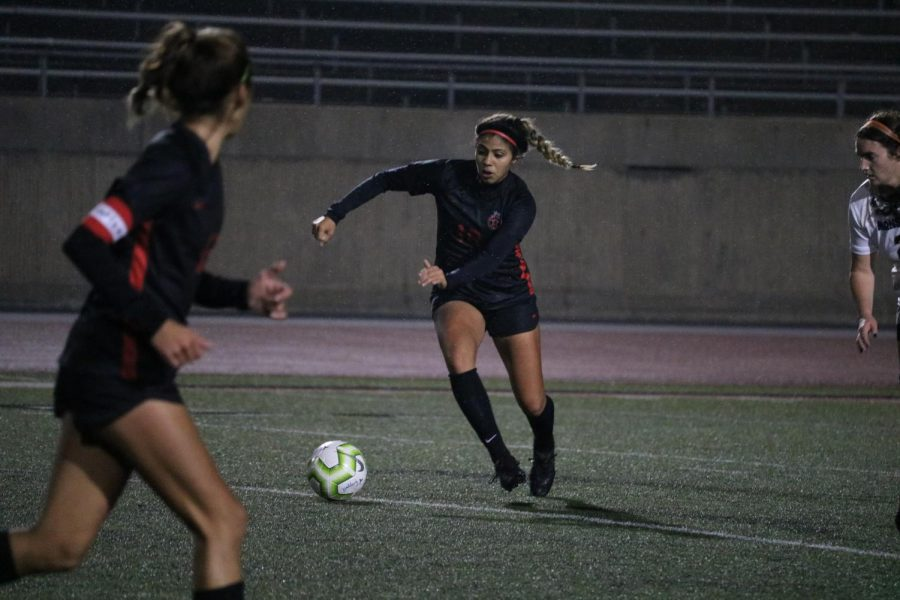 Coppell junior midfielder Renata Vargas passes against Mansfield at Buddy Echols Field on Tuesday. Vargas verbally committed  to The University of Texas Rio Grande Valley on Sept. 7.