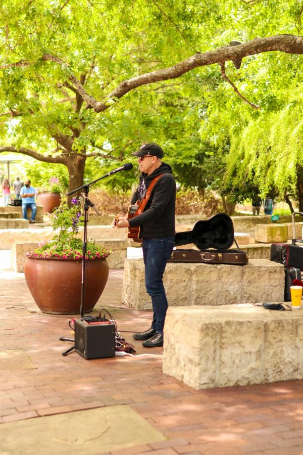 """Dave Garrison of the one-man-band, """"The Cool Side of Easy,"""" performs at the Dallas Arboretum and Botanical Garden on Sunday. The arboretum has a variety of events such as Artscape, Summer of Sculpture and Cool Thursdays Concert Series."""
