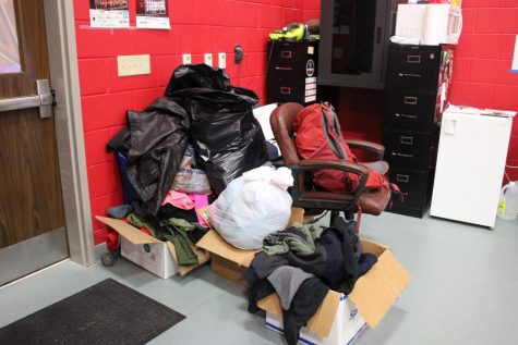 Coats and warm clothes are stored in the wrestling team's room in the CHS Indoor Facility on Thursday. Despite the cancellation of the annual Santa Slam tournament, the wrestling coat drive is taking place through Dec. 18.
