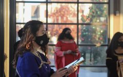 Coppell Choir senior Madrigal Amanda Grey sings at Old Town Coppell on Dec. 12. Madrigals practice COVID-19 safety precautions to continue their yearly tradition of caroling.