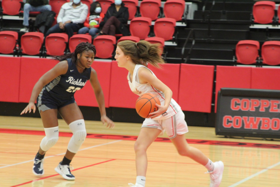 Coppell sophomore guard Jessie Huff drives past Richland junior Madison Jackson at the CHS Arena on Tuesday. The Cowgirls face Colleyville Heritage tomorrow at 6:30 p.m. in the CHS Arena.