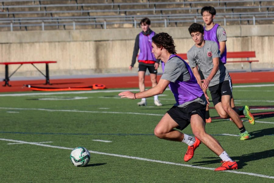 Coppell senior forward Brandon Gast chases during first period practice on Dec. 4 at Buddy Echols Field. Gast struggled with an ACL injury his sophomore year and is now back on varsity this school year.