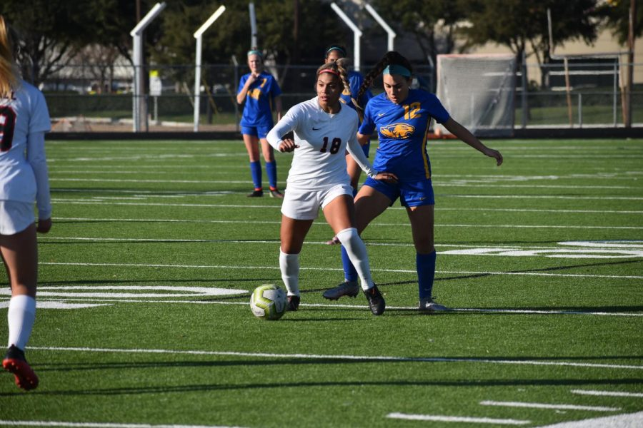 Coppell junior left forward Reneta Vargas drives against Frenship at Lesley Field yesterday. Coppell defeated Frenship, 6-0, in the Cowgirls' third match of the season.