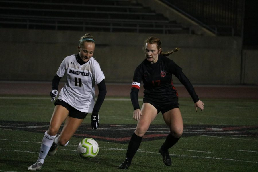Coppell senior defender Addison Martin fights for possession against Mansfield at Buddy Echols Field last night. Coppell and Mansfield tied, 1-1, in the Cowgirls' first scrimmage of the season.