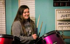 Coppell High School senior Jacqueline Gamborino plays drums at her house on Monday. Gamborino has been playing the drums ever since she was little and is on the Coppell tennis team.