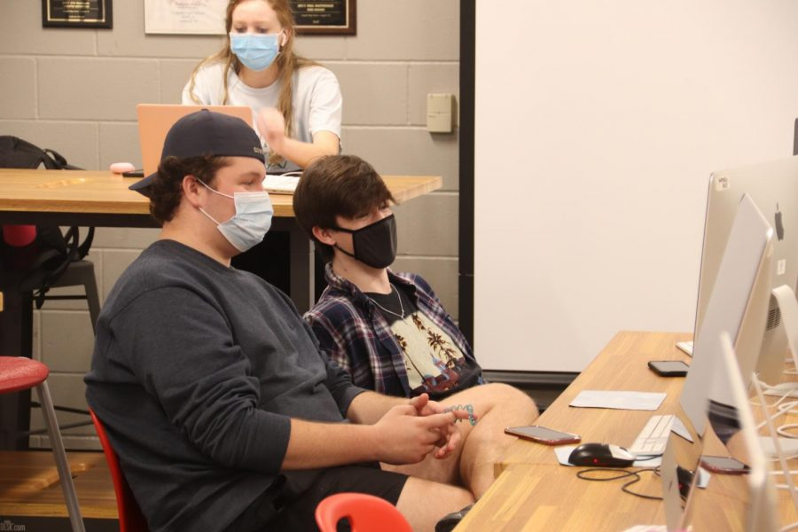 Coppell High School juniors Janae Wilson, Aiden Shaw and Will Manchester work in the KCBY-TV room during seventh period on Tuesday. KCBY-TV launched in 1995 to give daily announcements for CHS and celebrates its 25th anniversary this year.
