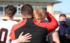 Coppell senior quarterback Ryan Walker hugs Coppell assistant Lincoln Hanke following Denton Guyer's 52-24 victory at C.H. Collins Athletic Complex on Saturday in the Class 6A Division II Region I bi-district playoffs. Coppell ends its season 6-4.