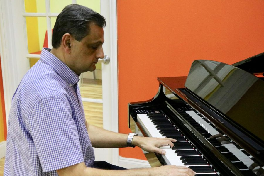 Coppell Music Academy owner Amir Khan plays the piano at Coppell Music Academy on Feb. 3. Khan established Coppell Music Academy in 2017 after teaching a piano program at the Coppell Recreation Center and years of performing, producing and teaching music.