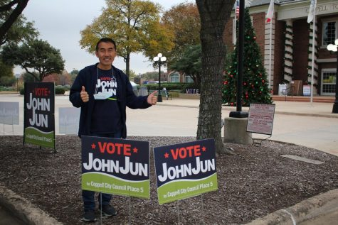 City council Place 5 John Jun greets early voters for the runoff election for Coppell City Council outside of Coppell Town Center on Dec. 2. Jun defeated Jim Walker in Tuesday's runoff election for Coppell City Council.