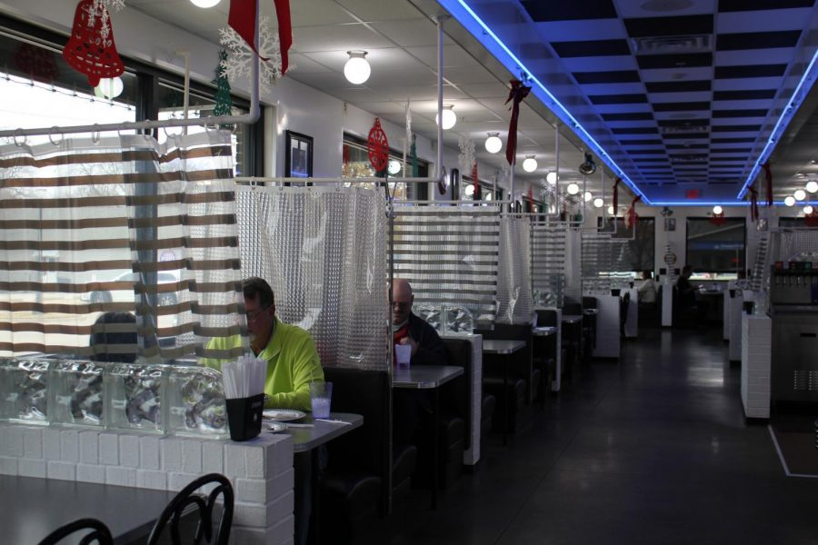 "Local Diner in Old Town Coppell serves customers on Tuesday at 25% capacity to slow down the spread of COVID-19. The City of Coppell has been urging its citizens to shop local with ""Be Vocal, Shop Local"" signs throughout the city."