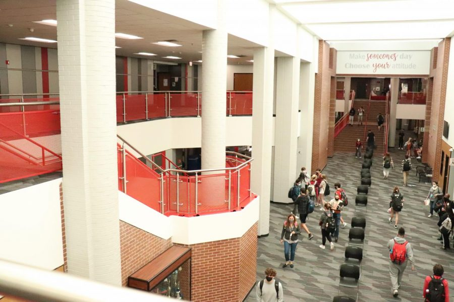 Coppell High School students navigate the main hall during passing period on Thursday. One year after the last regular day of school at CHS, the community is still upholding various coronavirus-related guidelines, such as social distancing and wearing masks.