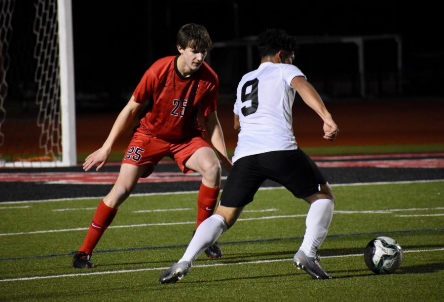 Coppell senior defender Collin MacDonald defends Irving's Luis Aguilera on Feb. 7 at Buddy Echols Field. MacDonald met Coppell senior defender Garrett Greaves in fourth grade when they joined the Andromeda Soccer Club together.