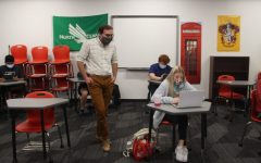 Coppell High School English II teacher Stephen Patino assists CHS sophomore Macy Baume during fifth period in his classroom on Oct. 19. Due to COVID-19, schools in the Dallas-Fort Worth area have had to change their education system to manage COVID-19 cases.