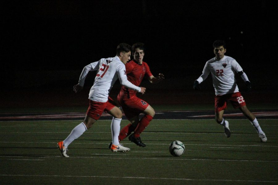 Coppell senior defender Garrett Greaves runs to take possession from Rockwall-Heath players during the match on Jan. 21 at Buddy Echols Field. Greaves met Coppell senior defender Collin MacDonald in fourth grade when they joined the Andromeda Soccer Club together.