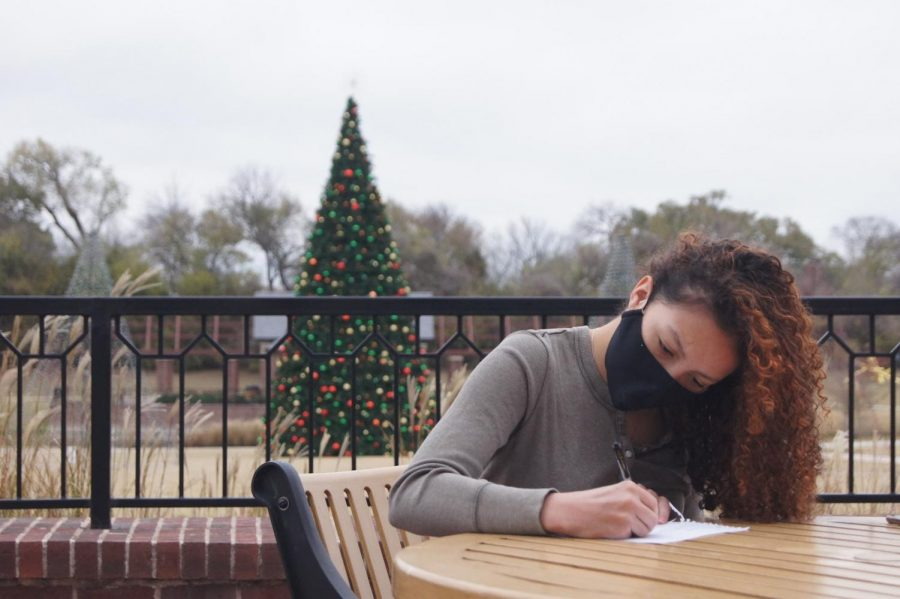 Coppell High School senior Social Butterflies Club president Jillian Richter writes a letter to the senior citizens of Coppell at Andy Brown Park on Thursday. Letters and other ongoing projects from the club provide the elderly an outlet to avoid loneliness during this pandemic.